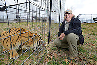 NWA Democrat-Gazette/BEN GOFF -- 03/09/15 Emily McCormack, curator of Turpentine Creek Wildlife Refuge, poses for a photo with Ringo, one of the many rescued tigers at the facility near Eureka Springs on Monday Mar. 9, 2015.