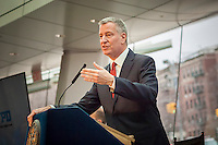 New York Mayor Bill de Blasio brief sthe media at a press conference on 2016 crime statistics at the Brooklyn Museum on Wednesday, January 4, 2017. 2016 annual shooting incidents fell below 1000 for the first time ever as well as the lowest incidences of reported crime since the introduction of Compstat. (© Richard B. Levine)
