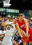 17 January 2010: University of Vermont Catamount forward Garrett Kissel, a Junior from Springfield, MA, tries to keep a rebound away from Boston University Terrier forward Valdas Sirutis, a Senior from Gargzdai, Lithuania, at Patrick Gymnasium in Burlington, Vermont. The Catamounts, holding the lead for the entire game, defeated the Terriers 78-58. Mandatory Credit: Ed Wolfstein Photo