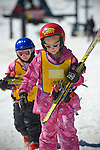Instructor Dominique Stedham works withShaelyn Sandusky, 7 years-old, in pink, and Hannah West, 6 years-old while spring skiing in the kids ski school at Mt. Rose Ski Tahoe