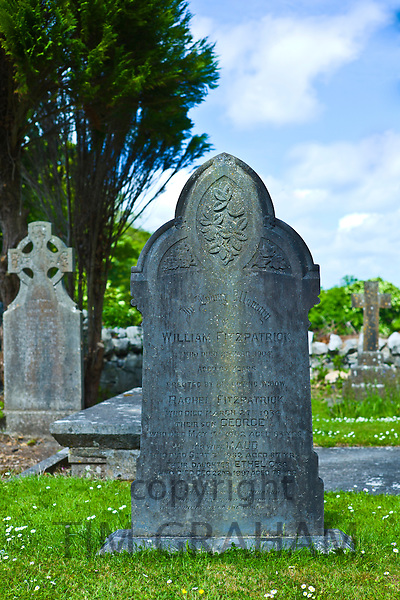 Gravestone of William Fitzpatrick and his family in churchyard at Corofin, County Clare, West of Ireland