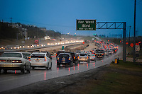 Mopac traffic jam during rain storm with rows of cars waiting to get off the Far West exit, Austin, Texas