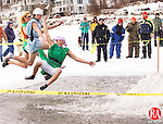 """Winsted, CT-30, January 2010-012710CM05  Members from the """"Highland Lake Super Heroes"""" jump into the frigid water during the 7th annual Penguin Plunge Saturday morning at Highland Lake in Winsted.   The Super Heroes raised approximately 18,000 dollars for this event, which goes to the Special Olympics.       --Christopher Massa Republican-American"""