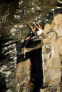 Masaaki Ikeda climbing on Tora no Ana, 5.13a at the sea cliffs of Jogasaki, Japan
