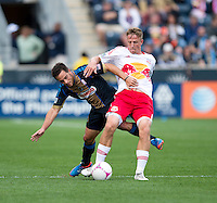 Jan Gunnar Solli (8) of the New York Red Bulls fights for the ball with Danny Cruz (44) of the Philadelphia Union during the game at PPL Park in Chester, PA.  New York defeated Philadelphia, 3-0.