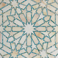 Castilla, a waterjet and hand-cut jewel glass mosaic, shown in Quartz and Aquamarine, is part of the Miraflores Collection by Paul Schatz for New Ravenna Mosaics.