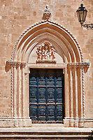 The Italian Gothic ogival main door of the medieval Cathedral of Ostuni built between 1569-1495  .Ostuni, The White Town, Puglia, Italy.