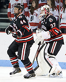Dax Lauwers (NU - 44), Chris Rawlings (NU - 37) - The visiting Northeastern University Huskies defeated the Boston University Terriers 6-5 on Friday, January 18, 2013, at Agganis Arena in Boston, Massachusetts.