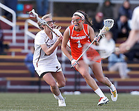 Syracuse University attacker Alyssa Murray (1) on the attack as Boston College midfielder Kate McCarthy (20) defends.  Syracuse University (orange) defeated Boston College (white), 17-12, on the Newton Campus Lacrosse Field at Boston College, on March 27, 2013.