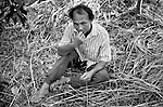 "Mekong Dam Victims - Laos. Mr. K.C. in the fruit garden that he and the villagers got as sole compensation for the loss of rice-fields and fishing opportunities. Apart from being far away from the village on the other side of the river, the fruit garden has not proved productive and is now more or less abandoned. After the construction of the Theun-Hinboun Dam in Laos more than 29,000 people in 71 villages have lost fisheries, rice fields, vegetables gardens and fresh drinking water supplies as a result of the dam. An expansion project is currently under construction and will displace another 4,200 mostly indigenous people from their lands in the reservoir area and displace or negatively affect another 50,000 people living downstream, on project construction lands, and in resettlement host villages. Known as ""The Mother of Waters"", more than 60 million people depend on the Mekong river and its tributaries for food, fresh water, transport and other aspects of daily life. The construction of big dams is now threatening the life of these people aswell as the vital and unique ecosystem of the river."
