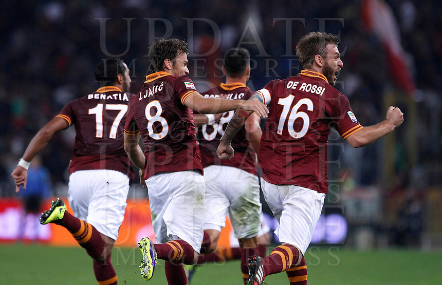 Calcio, Serie A: Roma vs ChievoVerona. Roma, stadio Olimpico, 31 ottobre 2013.<br /> AS Roma forward Marco Borriello, third from left, celebrates with teammates, from left, Mehdi Benatia, Adem Ljajic and Daniele De Ross, right, after scoring during the Italian Serie A football match between AS Roma and ChievoVerona at Rome's Olympic stadium, 31 October 2013.<br /> UPDATE IMAGES PRESS/Isabella Bonotto