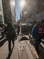 Clear plastic bags for security purposes on Super Bowl Boulevard in Midtown Manhattan in New York on Thursday, January 30, 2014. Despite the game being held in New Jersey on February 2 sports fans are packing New York to take part in the multitude of activities planned around the game including the 13 block stretch of Broadway, running from 34th street through 47th street that will host Super Bowl Blvd. from January 29 to February 1. (© Richard B. Levine)