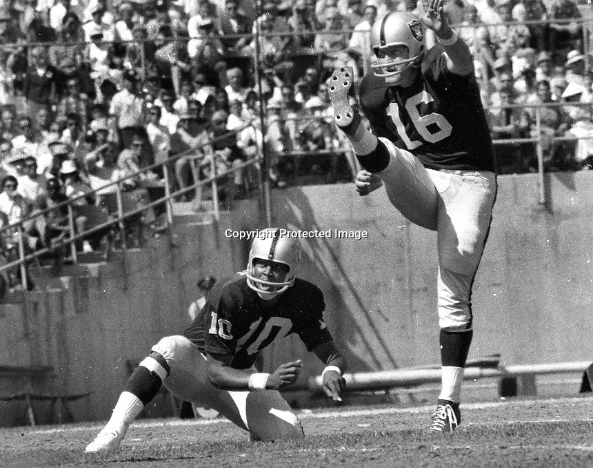 Oakland Raiders George Blanda kicks field goal out of the hold of reserve QB Eldridge Dickey #10. (1968 photo by RonRiesterer)