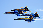 The Blue Angels in diamond formation make a pass down the crowd line during the First Annual California Capital Airshow at Mather Airport in March of 2006. Mather Airport, formerly Mather Air Force Base, is located east of Sacramento, California. The Blue Angels fly the Boeing built F/A-18 Hornet. Photographed 03/06