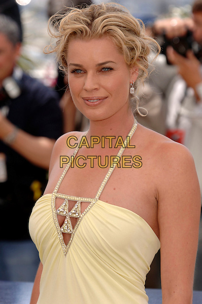 """REBECCA ROMIJN. """"X-Men 3: The Last Stand"""" photocall .59th International Cannes Film Festival, France.22nd May 2006.Ref: PL.half length halterneck yellow.www.capitalpictures.com.sales@capitalpictures.com.©Phil Loftus/Capital Pictures"""