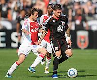 DC United forward Santino Quaranta (25) shields the ball against AFC Ajax defender Daley Blind (17)    AFC Ajax defeated DC United 2-1 during an International Friendly at RFK Stadium Sunday May 22, 2011.