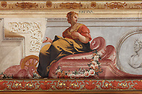 Detail of Fortuna or wealth, from the allegorical trompe l'oeil ceiling fresco painted by Antonio Simoes Ribeiro and Vicente Nunez, in the Black Room of the Joanina Library, or Biblioteca Joanina, a Baroque library built 1717-28 by Gaspar Ferreira, part of the University of Coimbra General Library, in Coimbra, Portugal. The Casa da Livraria was built during the reign of King John V or Joao V, and consists of the Green Room, Red Room and Black Room, with 250,000 books dating from the 16th - 18th centuries. The library is part of the Faculty of Law and the University is housed in the buildings of the Royal Palace of Coimbra. The building is classified as a national monument and UNESCO World Heritage Site. Picture by Manuel Cohen