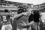 2013 May 27: Josh Offit #25 embraces his coach John Danowski after they beat the Syracuse Orange 16-10 to win the NCAA lacrosse national championship at Lincoln Financial Field in Philadelphia, PA.