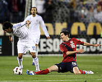 Sacha Kljestan(16) of the USA MNT slips the ball past Celso Ortiz(15) of Paraguay during an international friendly match at LP Field, in Nashville, TN. on March 29, 2011. Paraguay won 1-0.