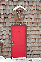 Cedar siding and red doors at Stokely Creek Lodge in Ontario, Canada.