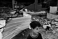 Baghdad, Iraq, March 28, 2003.This young boy was sleeping less than 50 meters away from the Alwiyah  communication center when it was completely destroyed by an US air strike at 7am.