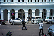 Pedestrians walk past British colonial structures in Fort, Colombo, Sri Lanka.  Photo: Sanjit Das/Panos