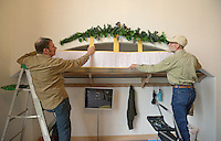 NWA Democrat-Gazette/BEN GOFF @NWABENGOFF<br /> Ross Hinshaw (left) and Ivan Andersen hang copies of pages from the church registry on Friday May 20, 2016 while decorating in celebration the 130th anniversary of Springdale Adventist Fellowship.