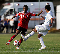 Julio Ortiz (5) of Guatemala tries to block the cross of Kiel Pierre (17) of Trinidad & Tobago  during the group stage of the CONCACAF Men's Under 17 Championship at Jarrett Park in Montego Bay, Jamaica. Trinidad & Tobago defeated Guatemala, 1-0.