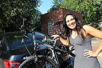 NWA Democrat-Gazette/FLIP PUTTHOFF <br /> Her car is her office where Monica Gutierrez carries her bicycle, shoes for the array of business and fitness activities she enjoys, plus tools for carpentry and other work.