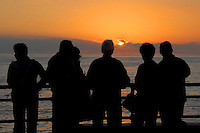 A group watch the sunest from the Santa Monica Pier on Sunday, January 9, 2011.
