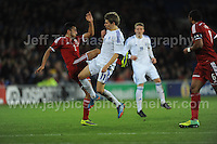 Neil Taylor of Wales and goalscorer Riku Riski of Finland battle against each other during the Wales v Finland Vauxhall International friendly football match at the Cardiff City stadium, Cardiff, Wales. Photographer - Jeff Thomas Photography. Mob 07837 386244. All use of pictures are chargeable.