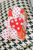 Detail of a beautifully wrapped present tied with a polka dot ribbon