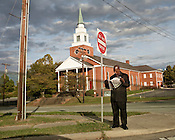 October 08, 2009. Durham, North Carolina.. A member of the Nation of Islam reads the organization's self published newspaper, the Final Call, on a corner across the street from a church near downtown Durham.