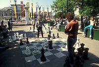 AJ2140, chess, Geneva, Switzerland, Europe, Men playing a giant public chess game at the Promenade des Bastions in Geneva.