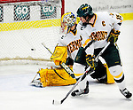 30 January 2010: University of Vermont Catamount goaltender Rob Madore, a Sophomore from Pittsburgh, PA, gives up a third period goal to the University of Maine Black Bears at Gutterson Fieldhouse in Burlington, Vermont. The Maine Black Bears and the Catamounts played to a 4-4 tie in the second game of their America East weekend series. Mandatory Credit: Ed Wolfstein Photo