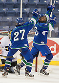 Peter Gintoli (Salve Regina - 27) and Parker Bowen (Salve Regina - 16) celebrate Bowen's goal. - The Wentworth Institute of Technology Leopards defeated the Salve Regina University Seahawks 2-1 on Tuesday, November 12, 2013, at Tsongas Arena in Lowell, Massachusetts.