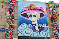 "Mesa, Arizona. October 28, 2012 - The Day of the Dead is a religious holiday celebrated in Mexico with a solemn mood to remember dead loved ones. However, in the Southwest of the United States and in states like Arizona, the holiday takes a form of a cultural festivity, the turning the traditional ""Día de los Muertos"" into a festival-like event. Artwork by local artists is an essential feature of the Day of the Dead celebrations in the Southwest of the U.S. This tradition can be traced to Mexico's great artist Jose Guadalupe Posada, who painted skulls to criticize dictator Porfirio Díaz and the rich. Photo Eduardo Barraza © 2012"