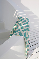 A length of eau de nil and cream cotton and silk is draped on a curved wall on the roof terrace