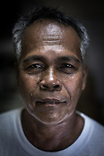Ernesto Betasolo poses for a photo in the Casa where the fisherman bring to sell their sustainably caught tuna in Puerto Princesa, Palawan in the Philippines. <br /> Photo: Sanjit Das/Panos for Greenpeace