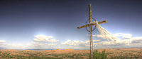 A hilltop cross on the road from Santa Fe to Taos, New Mexico. <br />