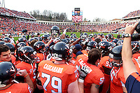 CHARLOTTESVILLE, VA- NOVEMBER 12: Virginia Cavalier players huddle before the game against the Virginia Tech Hokies on November 28, 2011 at Scott Stadium in Charlottesville, Virginia. Virginia Tech defeated Virginia 38-0. (Photo by Andrew Shurtleff/Getty Images) *** Local Caption ***