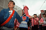 A large pink phallus is carried on a mikoshi or portable shrine by transvestites through the streets during the Kanamara matsuri or Iron Phallus festival in Kawasaki Daishi, Kanagawa, April 2nd 2006