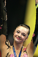 Anna Bessonova of Ukraine smiles during event final awards at 2006 Portimao World Cup of Rhythmic Gymnastics on September 10, 2006 at Portimao, Portugal.  (Photo by Tom Theobald)