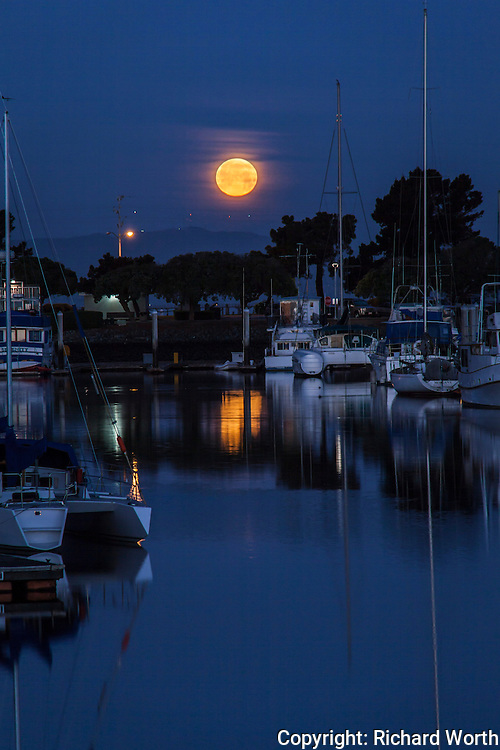 The setting Worm Full Moon reflected in the San Leandro Marina.  The March full moon is also known as the Crow Moon, Sap Moon and Lenten Moon.