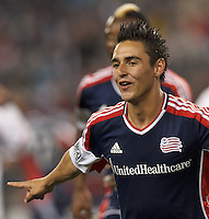 New England Revolution midfielder Diego Fagundez (14) celebrates his goal. In a Major League Soccer (MLS) match, the New England Revolution (blue) tied New York Red Bulls (white), 1-1, at Gillette Stadium on May 11, 2013.