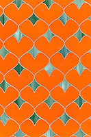 Hearts, a glass waterjet mosaic shown in Stella and Peacock Topaz, is part of the Erin Adams Collection for New Ravenna Mosaics.<br />