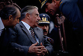 Talca, Chile<br /> September 1988<br /> <br /> General Augusto Pinochet and his advisors.<br /> <br /> In October 1988, General Pinochet ordered a plebiscite vote asking Chilean citizens whether he should continue in office. It produced a decisive &quot;no&quot; vote and the following year he lost the first presidential election in 19 years. However, under a constitution crafted by his advisors, he remained as army commander until 1998. <br /> <br /> Pinochet continued to wield enormous power until his arrest in London on human rights charges in October 1998.