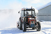blowing snow with a farm tractor equiped with a rear mounted snowblower