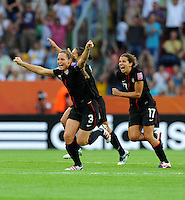 Christie Rampone (l) and Tobin Heath of team USA celebrate during the FIFA Women's World Cup at the FIFA Stadium in Dresden, Germany on July 10th, 2011.