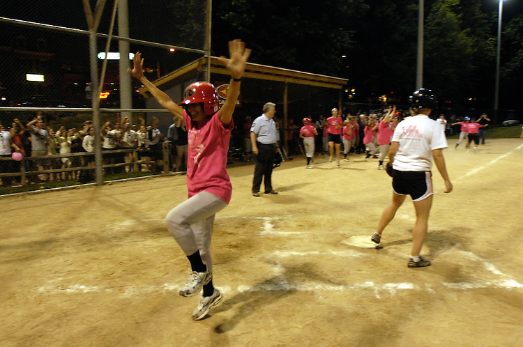 Jean Schmidt excitedly crosses home base to get the Congresswomen another point at the Women's Congressional Softball game at Guy Mason field on Tuesday night. Tuesday, July 14, 2009.
